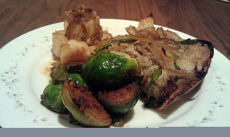 Brussels sprouts with white pepper and garlic, served with garlic shallot scallops and a lamb, onion, and asparagus pastry