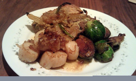 Garlic Shallot Scallops served with White Pepper Brussels sprouts and a Lamb, onion, and asparagus pastry photo