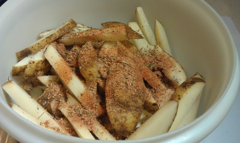 French fries with Cajun seasoning and oil photo