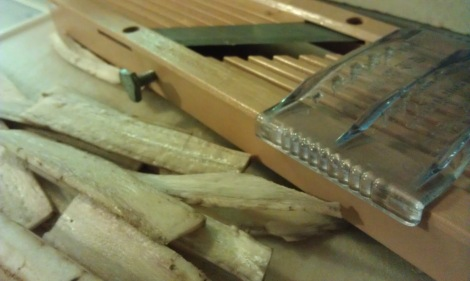 Slicing burdock (gobo) root with a mandoline (photo)