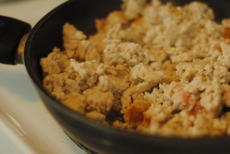 Larb Gai turkey cooking in a frying pan (photo)