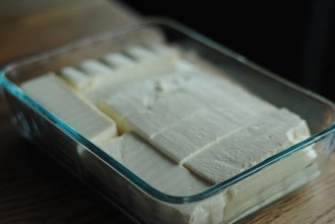 Lay tofu in a pan to marinate. This pan was a bit small, to be honest. (photo)