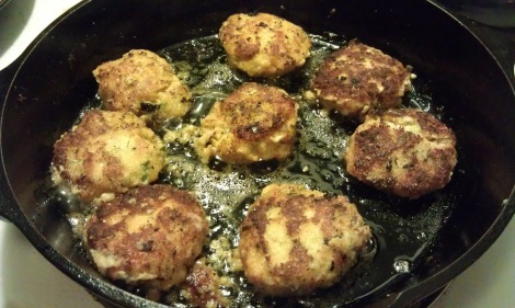 Fish patties frying in a cast iron skillet (low-amine, gluten-free, soy-free, dairy-free, low-fat, low-carb, paleo) photo