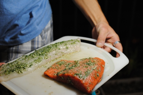 My sweetie (aka The Grillmaster) displaying cuts of true cod (low-amine) and salmon (high-amine) marinating in garlic, dill, and ascorbic acid (low-amine, gluten-free, soy-free, dairy-free, nut-free, paleo) photo
