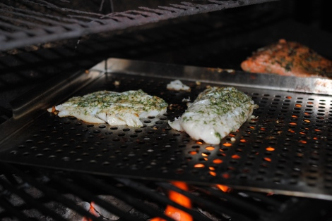 The Grillmaster going to town on grilling cod (low-amine, gluten-free, soy-free, dairy-free, nut-free, paleo) photo