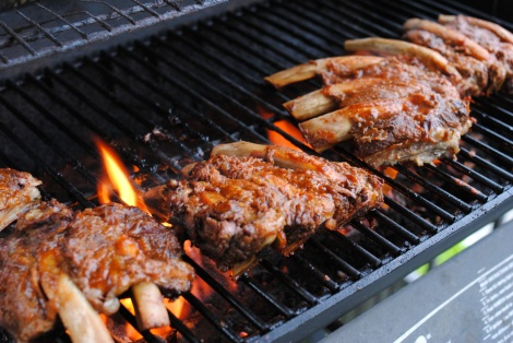 Low-Amine BBQ Beef Ribs finishing on the grill (photo)